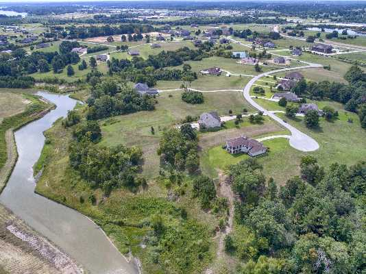 Oversized waterfront lot in a gated community!